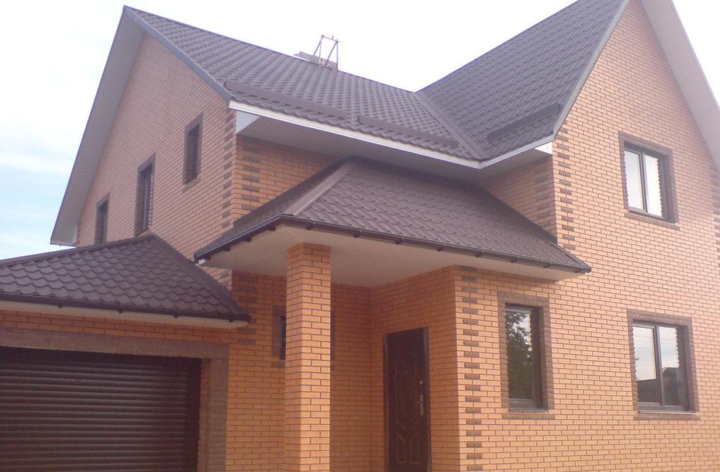 Частный дом из персикового кирпича фото